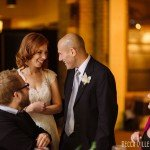 bride and groom greet guests at IMS Design Center wedding reception