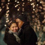 st paul engagement photographer couple in rice park at night in winter with lights on trees in backgrouns