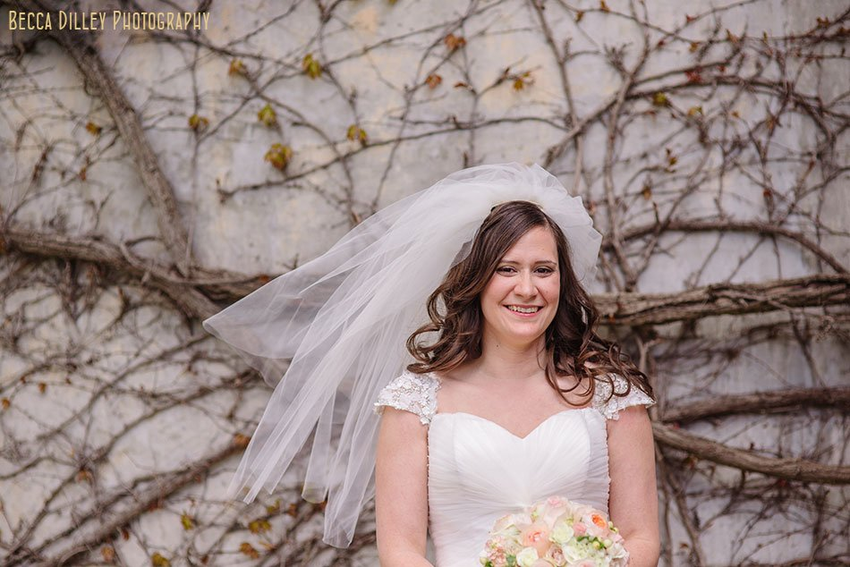 bride in front of ivy wall at St Maria Goretti church wedding madison wi
