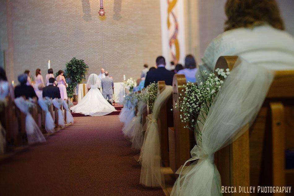 babys breath flowers on aisle at St Maria Goretti church wedding madison wi