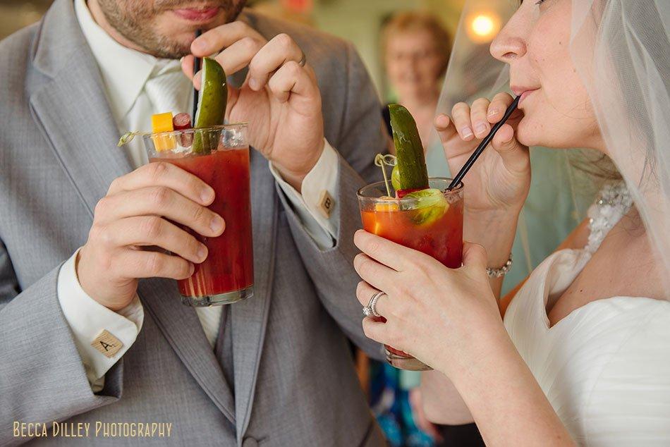 bride and groom sip bloddy marys Windsor Country Club wedding Madison Wi