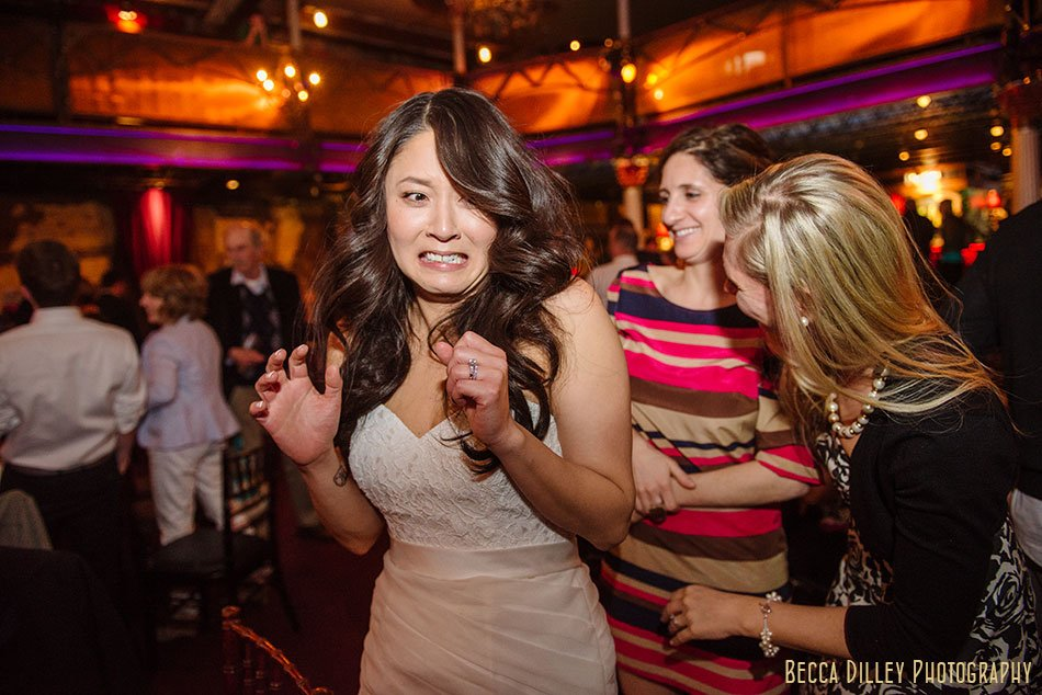 bride makes funny face at Varsity Theater wedding Minneapolis