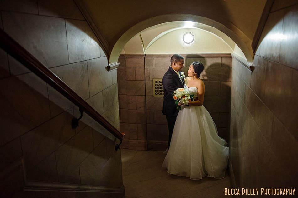 bride and groom in stairwell of jj hill libary st paul mn