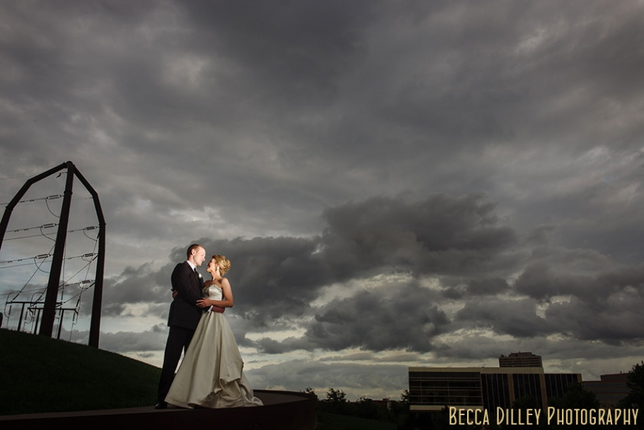 gold medal park wedding photo with thunderstorm clouds