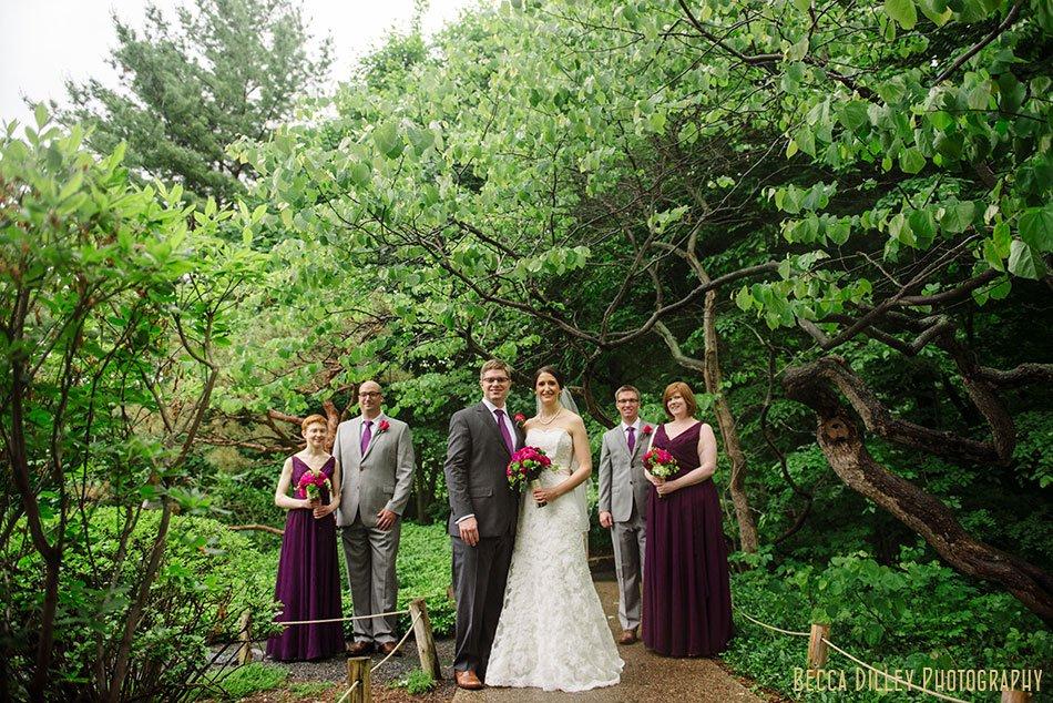 wedding party outside at rainy wedding at minnesota arboretum