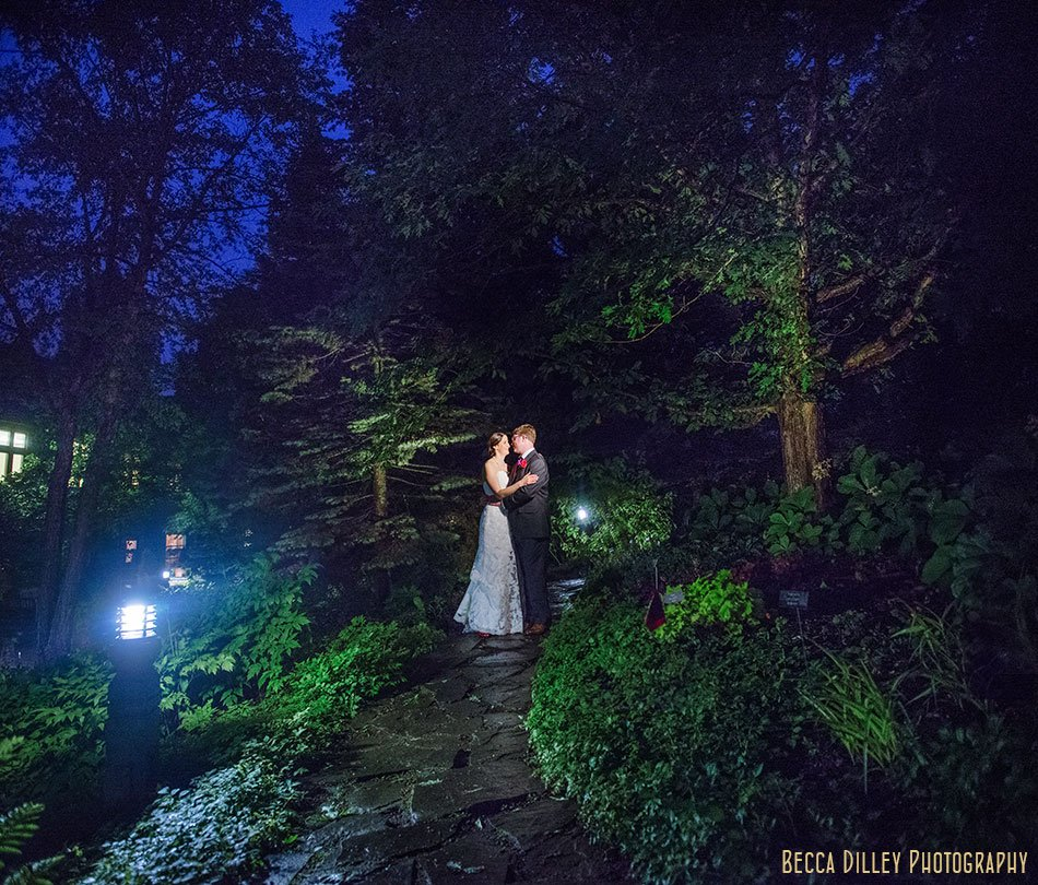 bride and groom outside at night for rainy wedding at minnesota arboretum