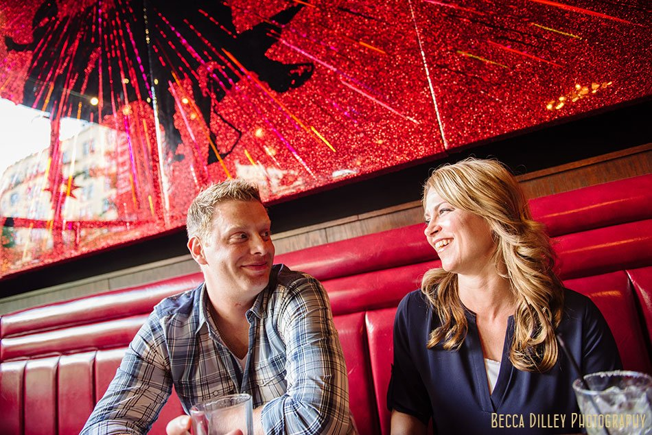 couple at barrio lowertown red booth