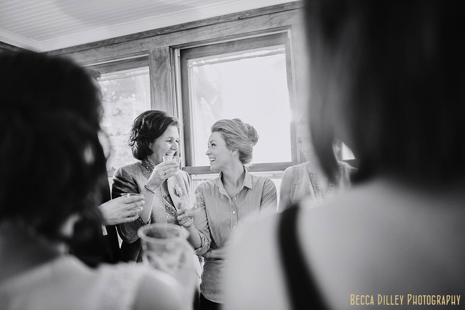 bride and mother share a moment during toast