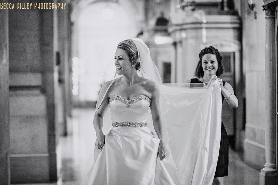 bride walking to meet groom for basillica wedding minneapolis