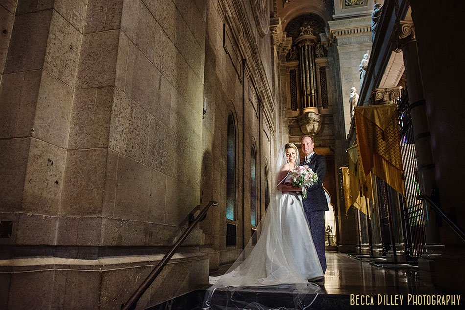 bride and groom in dark corner of basillica wedding minneapolis