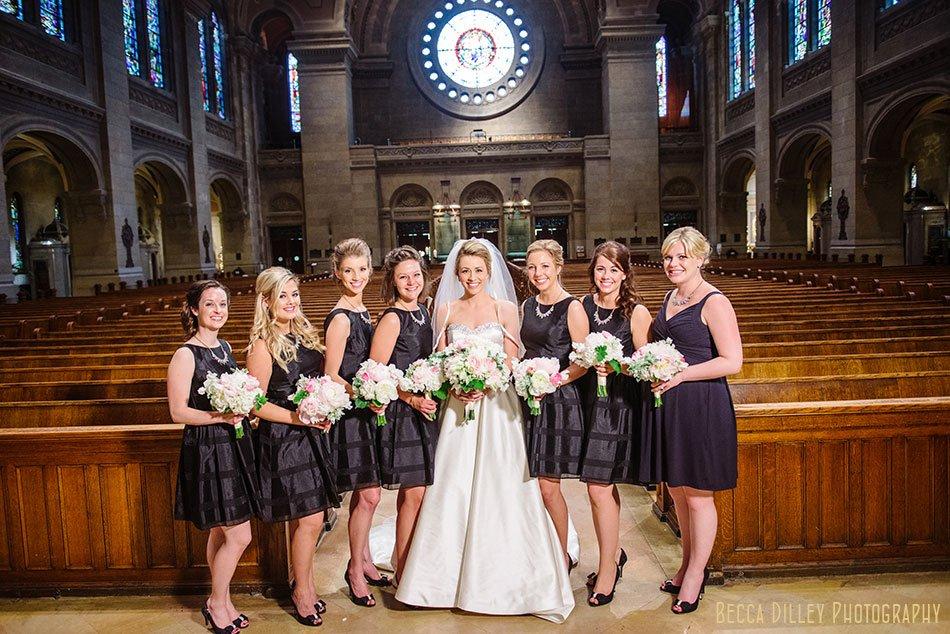 bridesmaids inside basillica wedding minneapolis