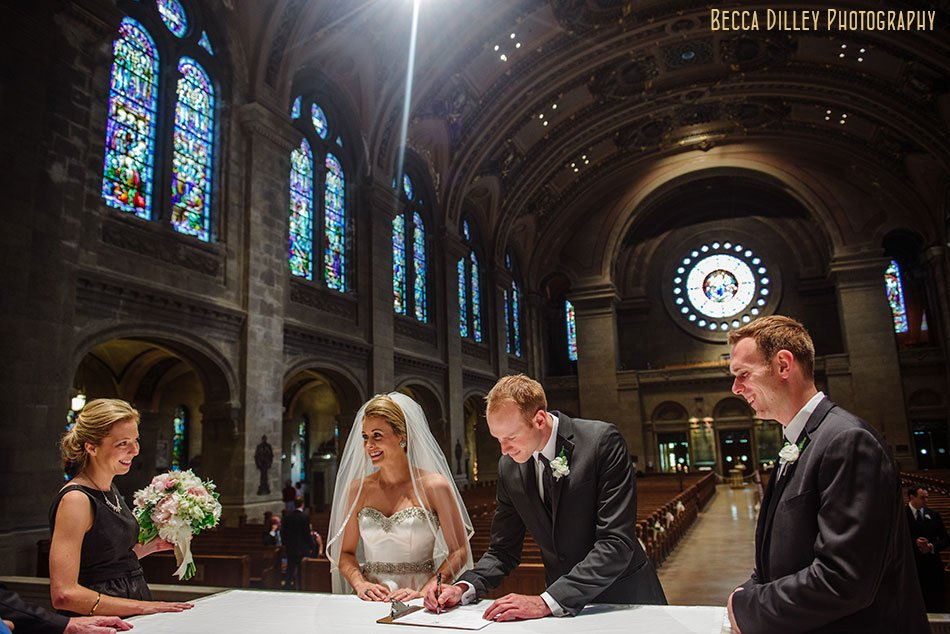 bride and groom sign marriage license for basillica wedding minneapolis