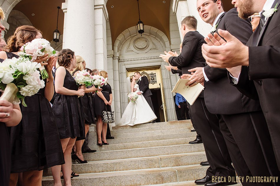 bride and groom kiss before exiting outisde basillica wedding minneapolis