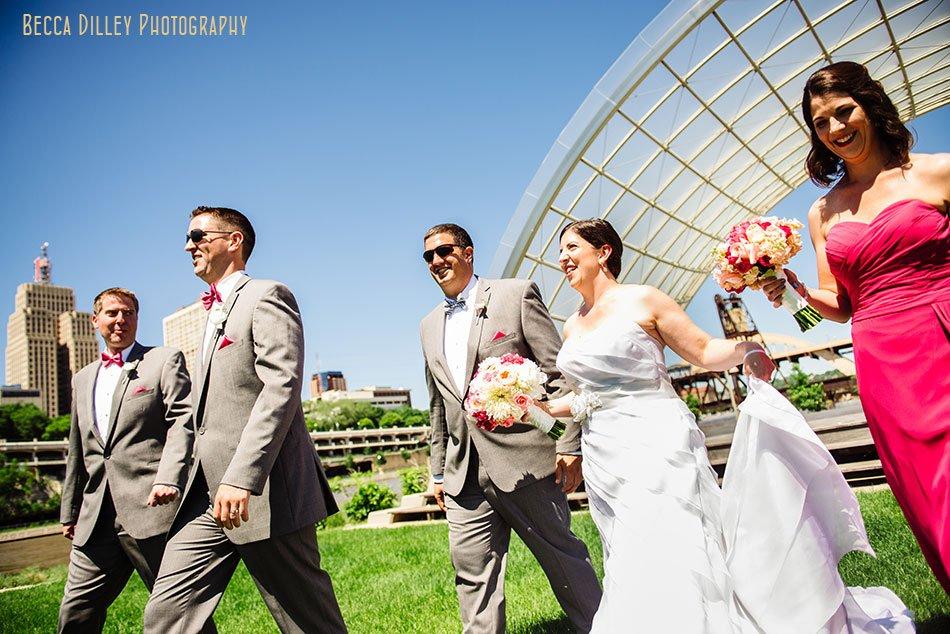 wedding party walks across raspberry island st paul mn