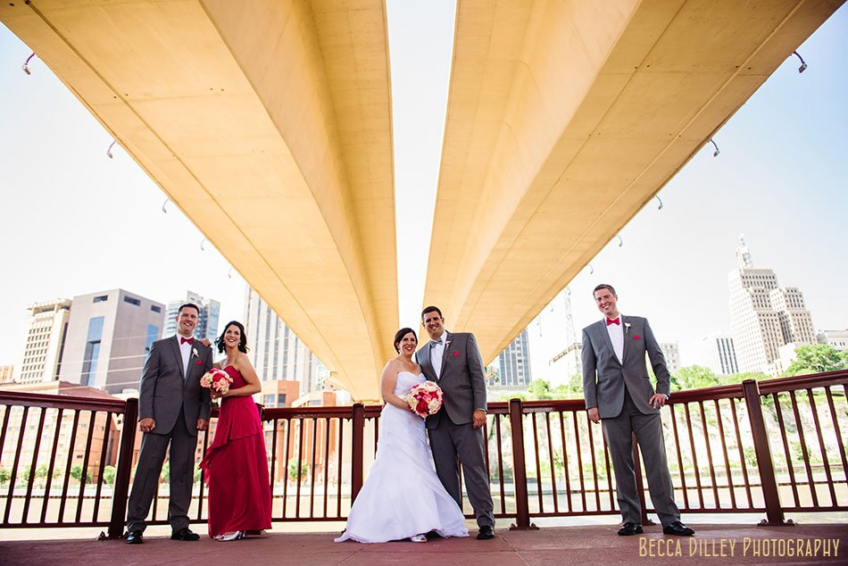 wedding party under bridge at raspberry island with st paul skyline