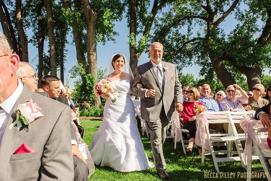 father walks bride down the aisle at raspberry island wedding