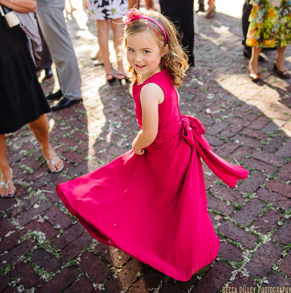flower girl in fushia dress during cocktail hour