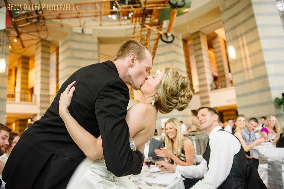 bride and groom kiss inside minnsota history center
