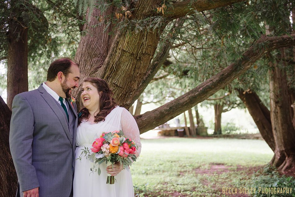 bride and groom under pines at hilltop in Spring Green WI