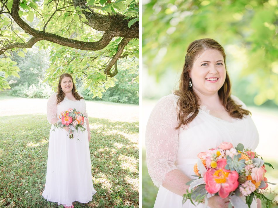 bride with succulent bouquet at hilltop in Spring Green WI