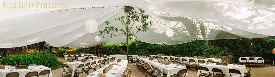wedding reception under tent at hilltop in Spring Green WI