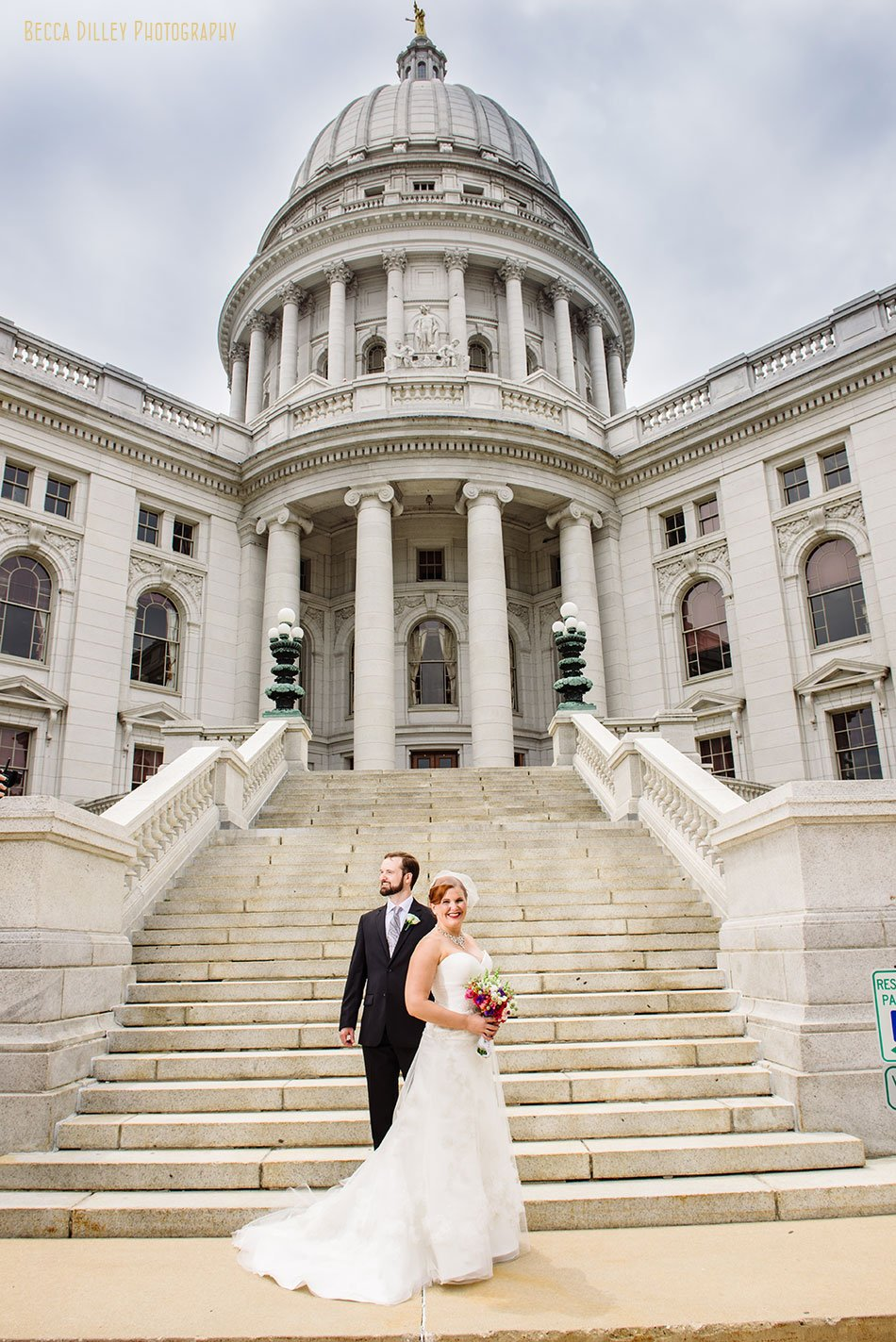 formal portrait bride and groom on steps of capitol wi