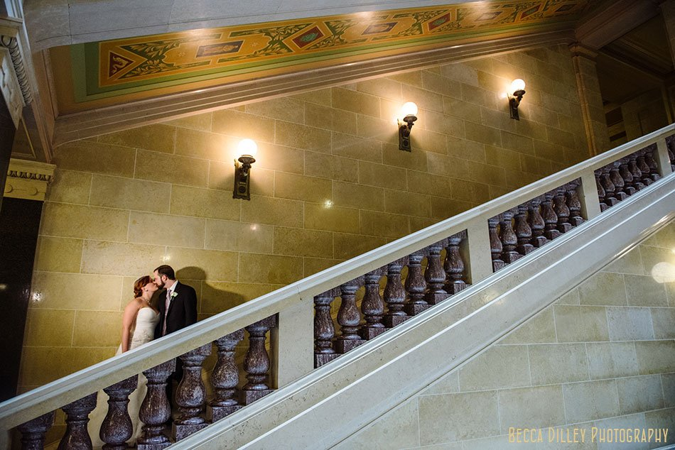 bride and groom on steps inside capitol madison wi wedding