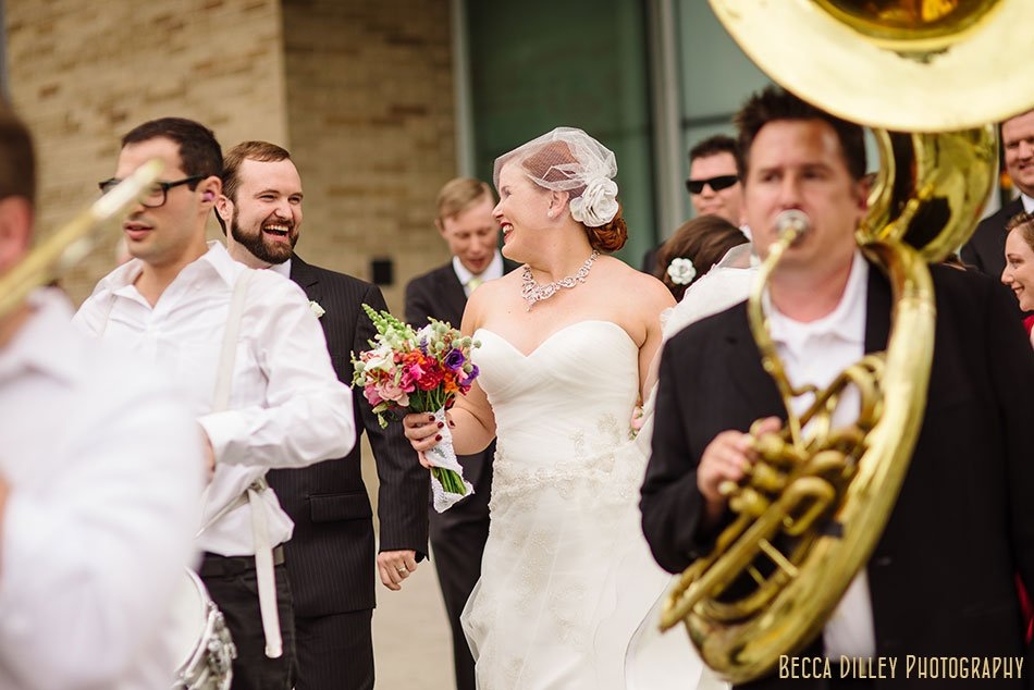 wedding with marching band second line around madison capitol