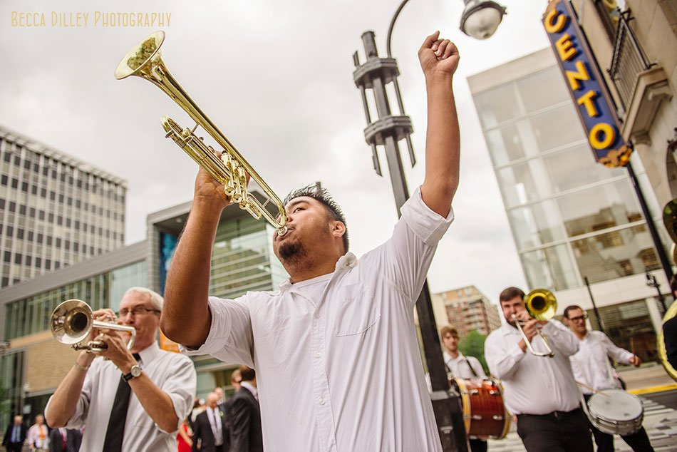 mama dig downs brass band for wedding with marching band second line around madison capitol