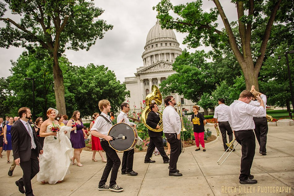 mama dig downs brass band walking wedding with marching band second line around madison capitol