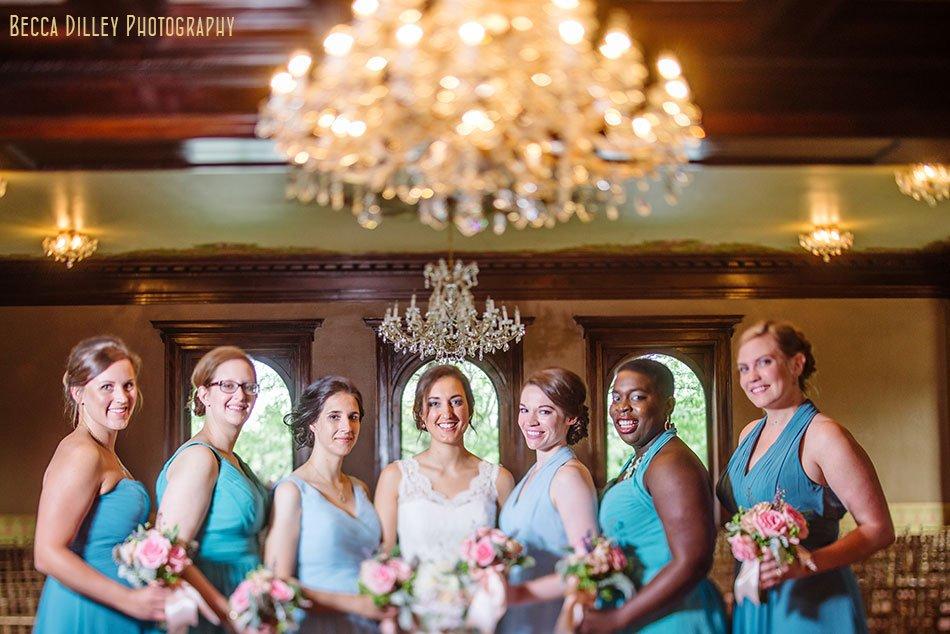 bridesmaids under chandelier at Semple mansion wedding minneapolis mn