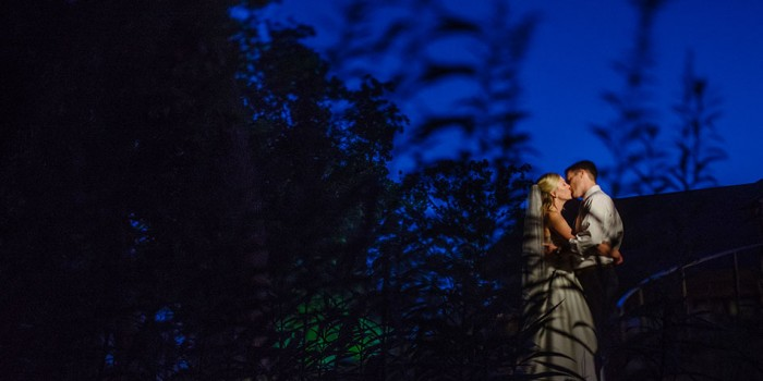 bride and groom at night at silverwood park minneapolis