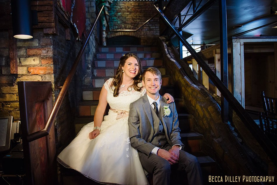bride and groom on stairs at loring pasta bar