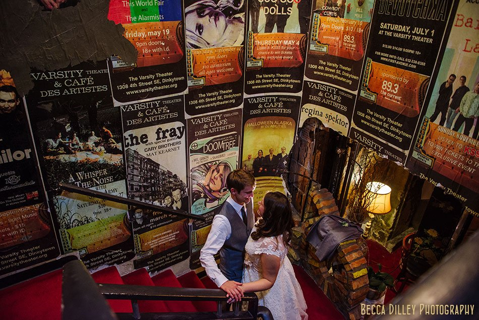 bride and groom with music posters varsity theater wedding reception