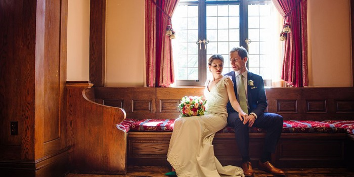 bride and groom in window seat at minneapolis club wedding