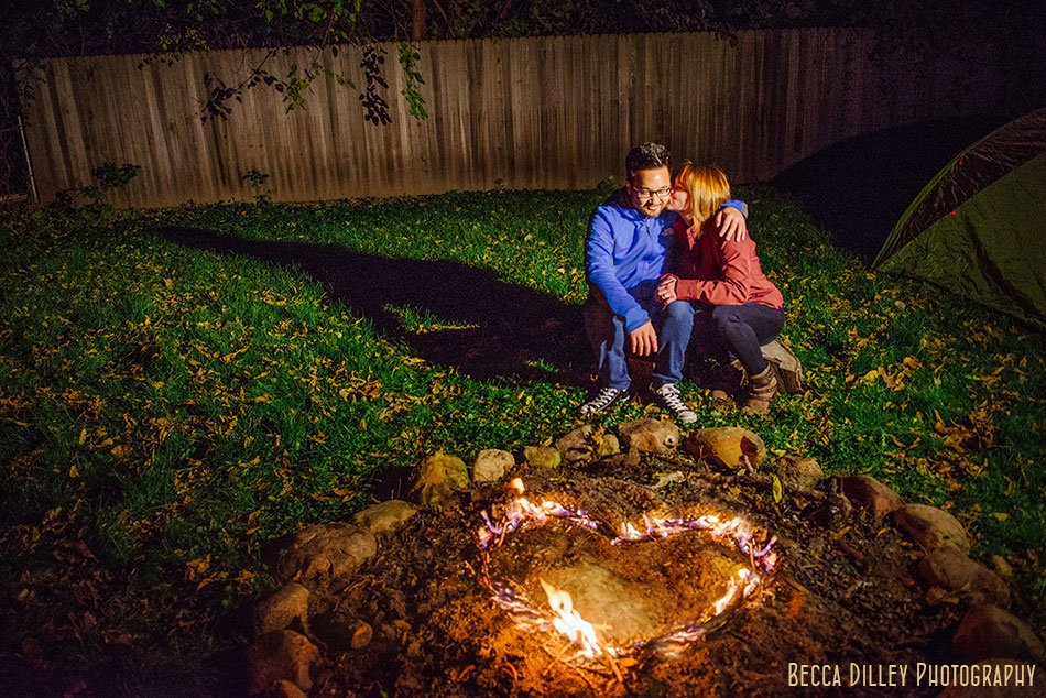 engagement photo in backyard with tent at night minneapolis