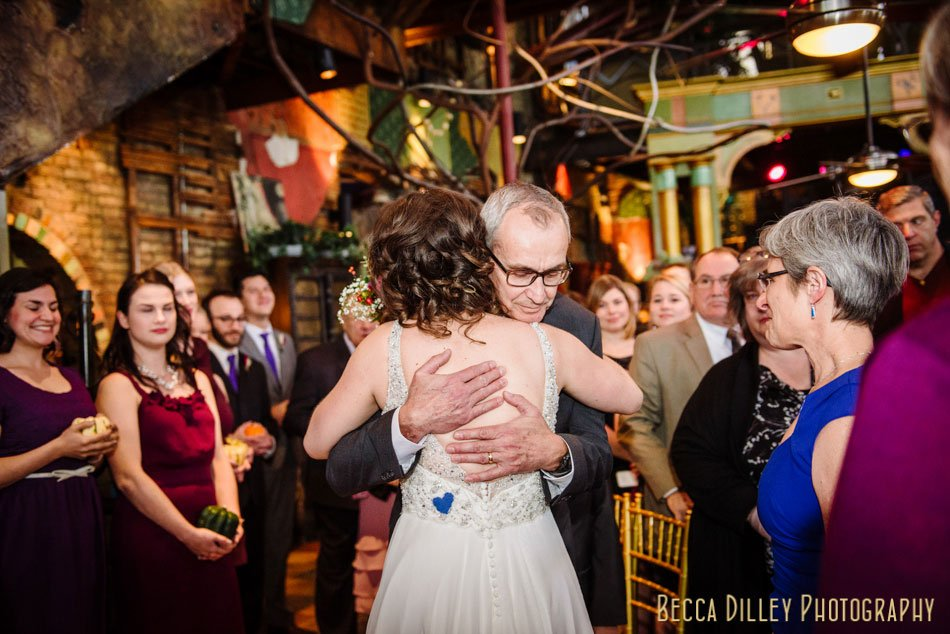 bride father hugs her at altar
