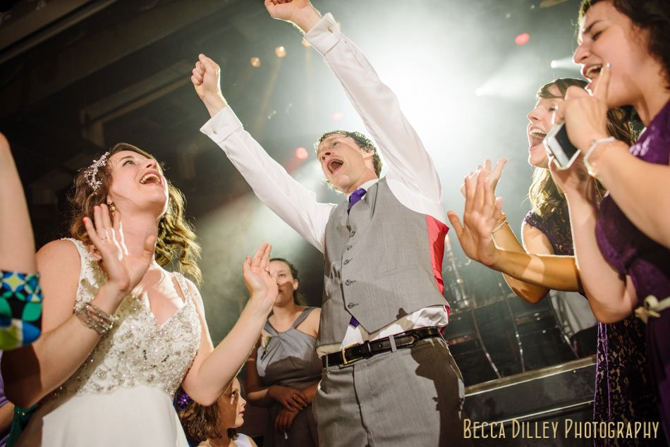 bride and groom dance with reckless abandon minneapolis wedding photographer