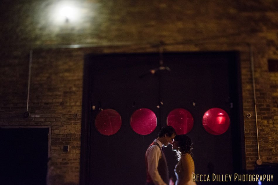 bride and groom exterior varsity theater at night minneapolis wedding photographer