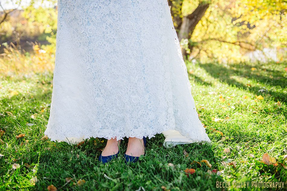 bride with blue tinted dress and blue shoes