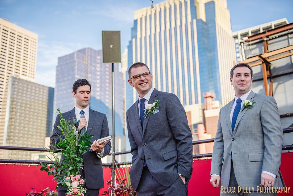 groom waits for bride on rooftop of solera restaurant downtown minneapolis wedding