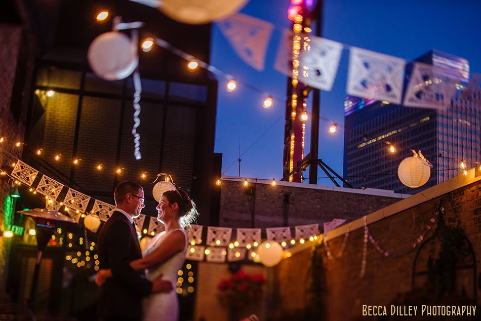 bride and groom at night on patio of solera restaurant downtown minneapolis wedding