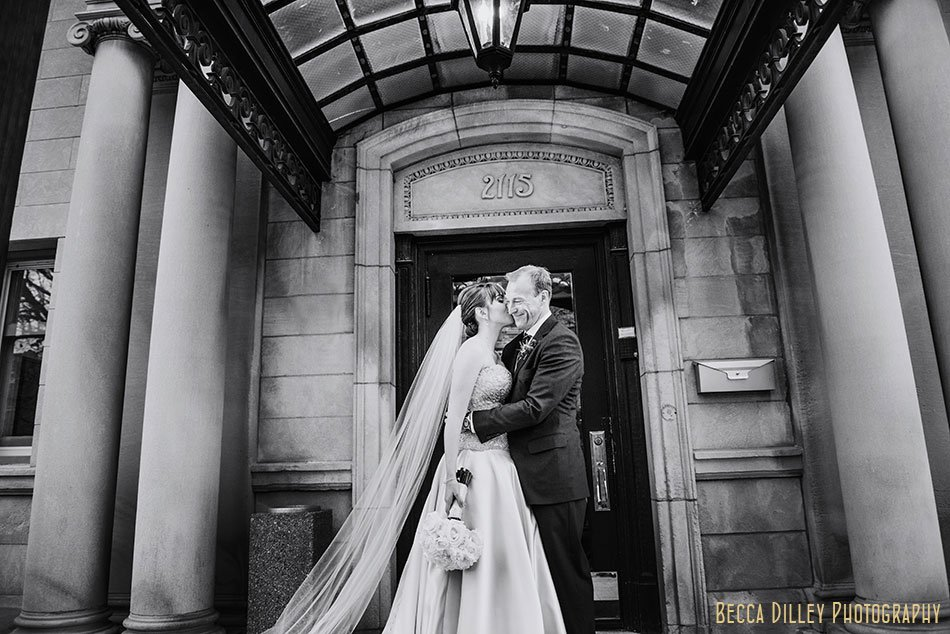 bride and groom under awning of minneapolis wedding at gale mansion