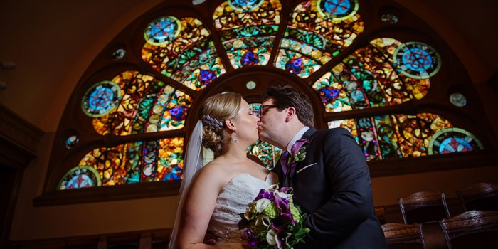 st paul wedding couple with dramatic stained glass