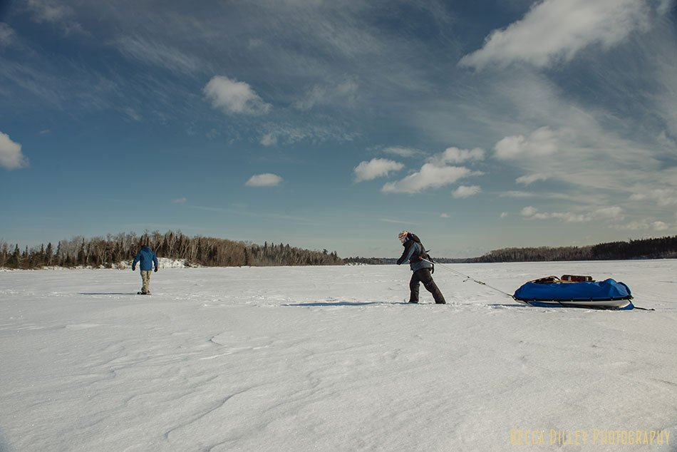 ely winter boundary waters sledding in food
