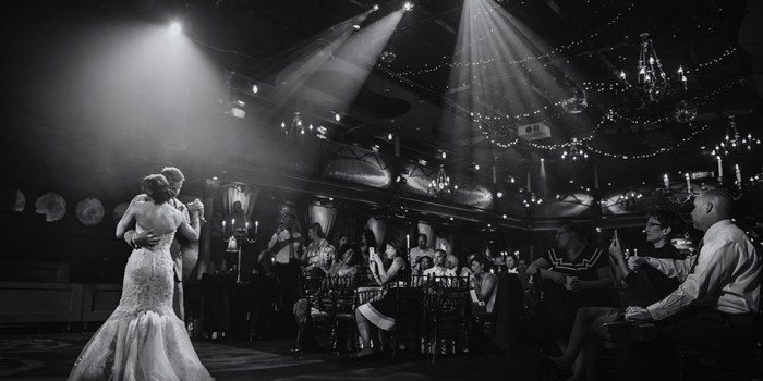 minneapolis wedding photographer first dance with dramatic lighting at the varsity theater
