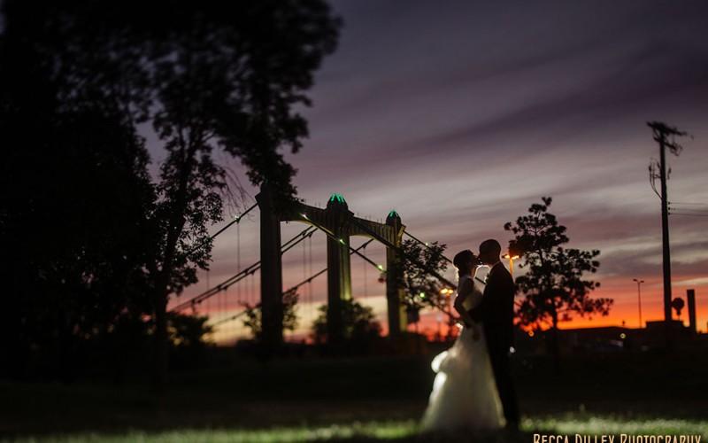 night wedding portrait on nicollet island minneapolis