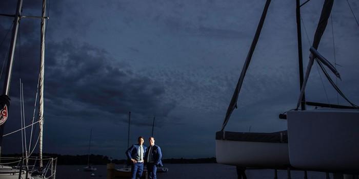wayzata boat club two grooms on dock at night
