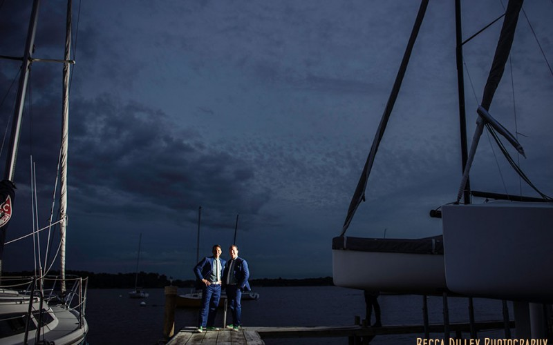 wayzata boat club two grooms on dock at night