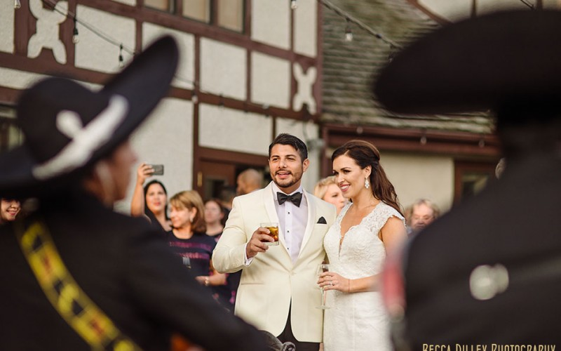 bride and groom with mariachi band edina country club